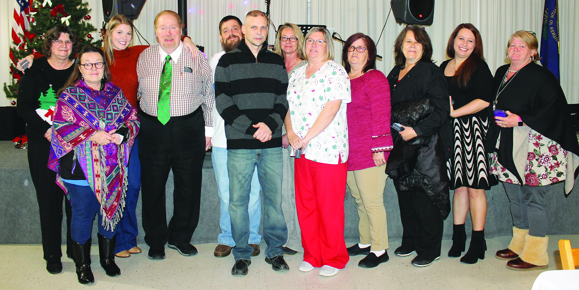6981ed2ba Casey Hospital employees on hand to receive their pins at the Christmas  party were